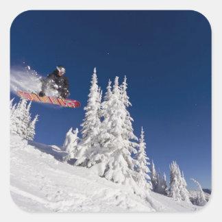 Snowboarding action at Whitefish Mountain Resort Square Sticker