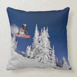 Snowboarding action at Whitefish Mountain Resort Throw Pillow