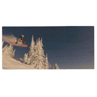 Snowboarding action at Whitefish Mountain Resort Wood USB Flash Drive