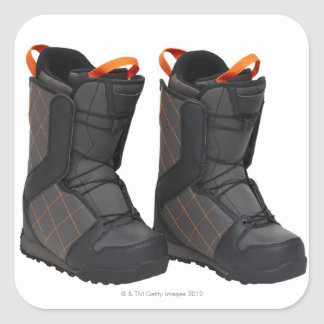 Snowboarding boots on white background, cut out square sticker