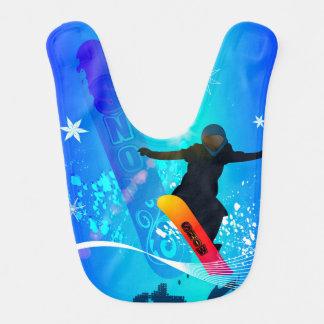 Snowboarding, snowboarder with board on blue backg bib