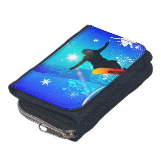 Snowboarding, snowboarder with board on blue backg wallets