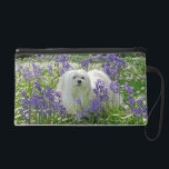 "Snowdrop the Maltese Wristlet/Purse Wristlet<br><div class=""desc"">This cute wristlet/purse features images of Snowdrop,  a sweet little Maltese Dog. On one side there is a photograph of her amongst the Bluebells and Daisies and the other contains a portrait of her lovely face surrounded by Spring Flowers.</div>"