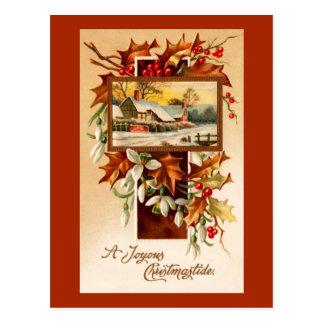 Snowdrops y acebo en navidad de un vintage de la postales