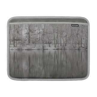 snowed trees reflected by the river sleeve for MacBook air