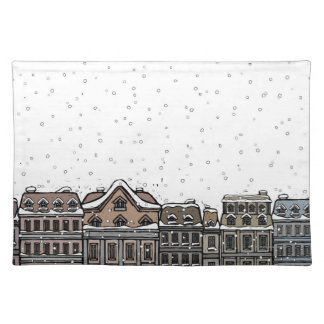 Snowfall over a city cloth placemat