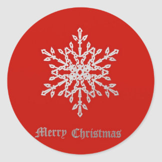 Snowflake on red classic round sticker