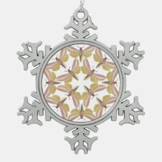 Snowflake ornament with pink hawk moths
