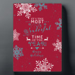 """Snowflakes Christmas Red Turquoise Wonderful Time Plaque<br><div class=""""desc"""">Red,  turquoise and white snowflakes winter Christmas holiday labels. The text says &quot;It&#39;s the most wonderful time of the year&quot; and &quot;happy holidays&quot;.  A pretty snowflake Xmas design. Modern design.</div>"""