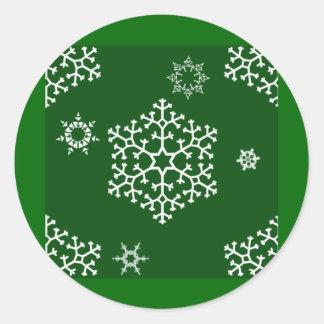 snowflakes_on_dark_green classic round sticker