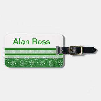Snowflakes on green luggage tag
