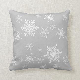 snowflakes on grey throw pillow