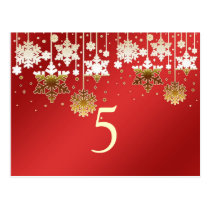 Snowflakes on red winter wedding Table number