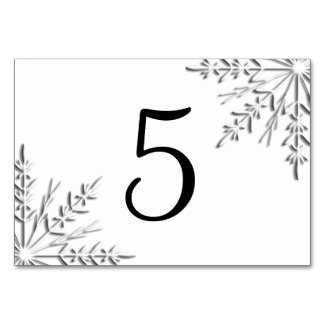 This table card features intricate silver tone snowflakes adorning the corners with a white background, perfect for a winter wedding reception or party