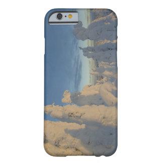 Snowghosts en la puesta del sol en la montaña 2 funda de iPhone 6 barely there