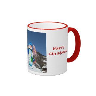 Snowman band singing on the hillside mug