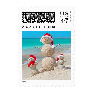 Snowman Family At Sea Beach In Santa Hat Postage