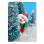 Snowman hiding or peeking from behind a tree greeting cards