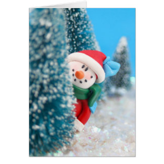 Snowman hiding or peeking from behind a tree card