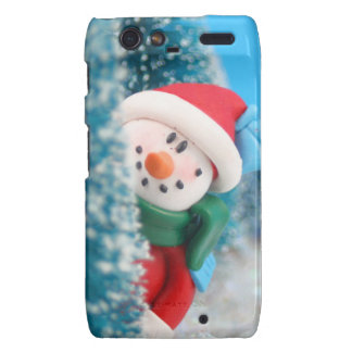 Snowman hiding or peeking from behind a tree droid RAZR cover