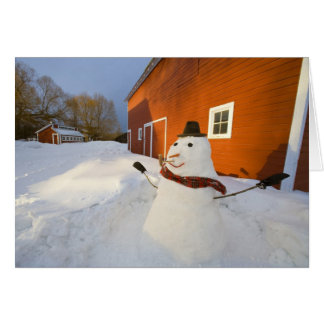 Snowman in front of red barn in Columbia Falls Greeting Cards