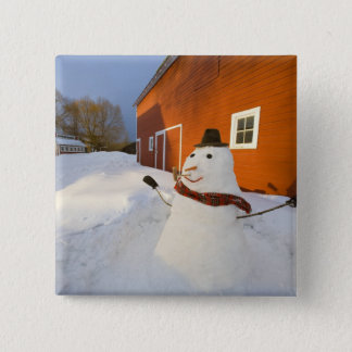 Snowman in front of red barn in Columbia Falls Pinback Button
