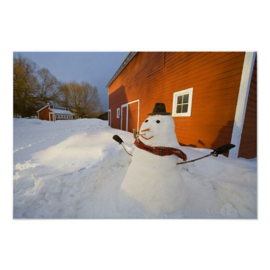Snowman in front of red barn in Columbia Falls Poster