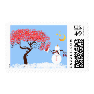 Snowman looking up at the moon postage stamp