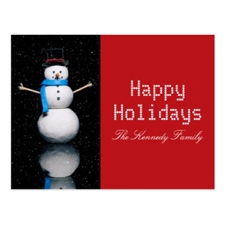 Snowman on a Black Background with snow falling Postcard