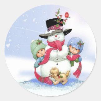 Snowman on christmas scene classic round sticker