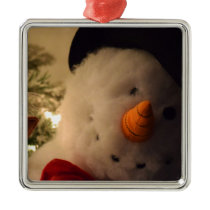Snowman Peeking Around the Christmas Tree Metal Ornament