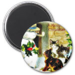 Snowman standing with holy leaves and cats around magnet