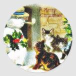 Snowman standing with holy leaves and cats around sticker