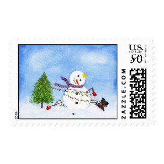 Snowman tangled in Christmas lights stamps