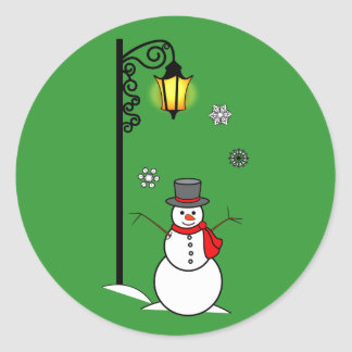 Snowman under a Lamppost in the Snow Classic Round Sticker