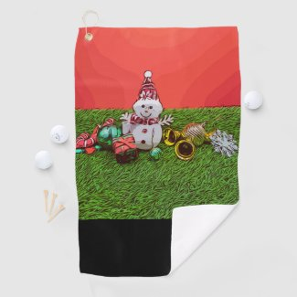 Snowman with Christmas ornament on green grass Golf Towel