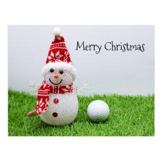 Snowman with golf ball on green grass Christmas Postcard