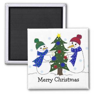 Snowmen Decorating a Christmas Tree Magnet