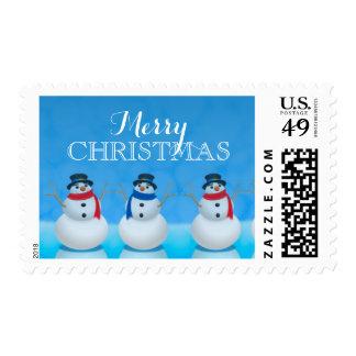 Snowmen in row against blue background stamp