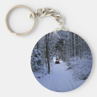 Snowmobiling after fresh snowfall Winter Key Chain