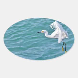 Snowy Egret In Flight Oval Sticker