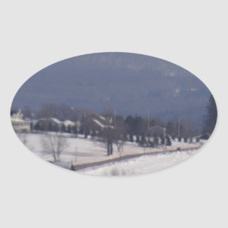Snowy little back country road oval sticker
