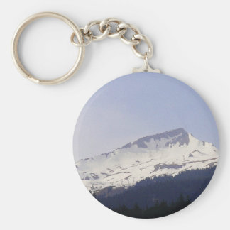 Snowy mountain before blue sky key chains