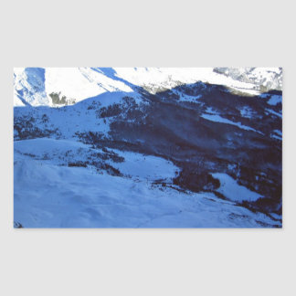 Snowy mountain on a sunny day rectangular sticker