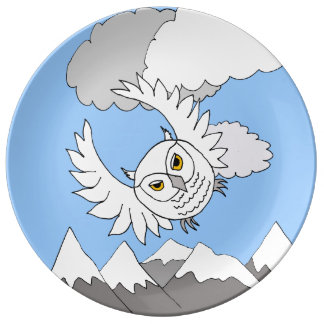 snowy owl flying above mountains porcelain plate