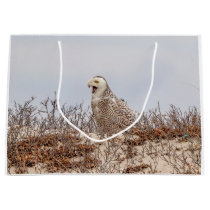 Snowy owl sitting on the beach large gift bag