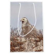 Snowy owl sitting on the beach medium gift bag