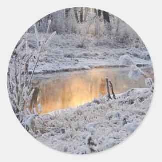 Snowy sunset classic round sticker