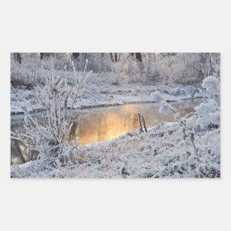 Snowy sunset rectangular sticker