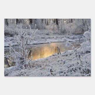 Snowy white winter landscape with light reflect sign